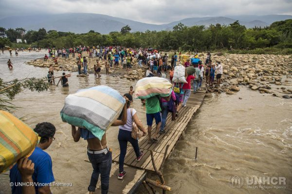 Venezuelan people cross the border to get to Colombia