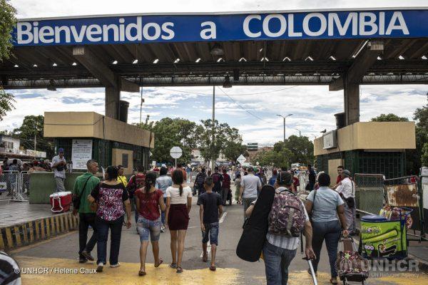 Venezuelans cross the border into Colombia via the Simon Bolivar International Bridge